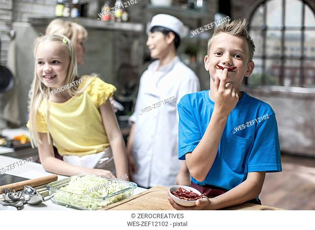 Kids and adults taking cooking course
