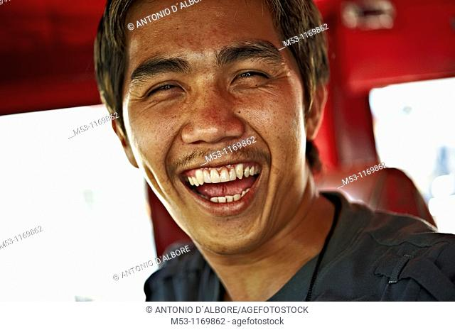 Jeepney driver laugh and look in camera  Mandaluyong City  Metro Manila  Philippines