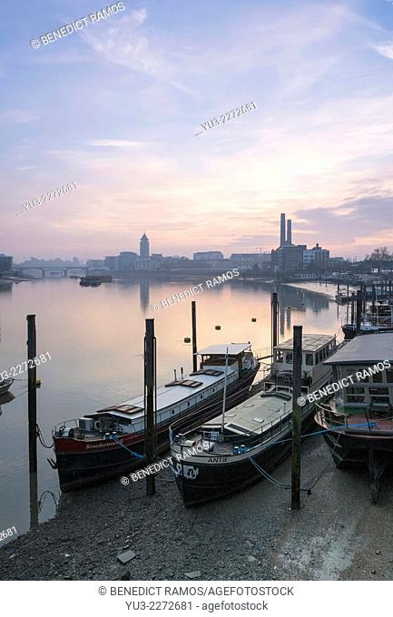 Houseboats on the River Thames looking towards the old Lots Road power station and Chelsea Harbour, London, UK