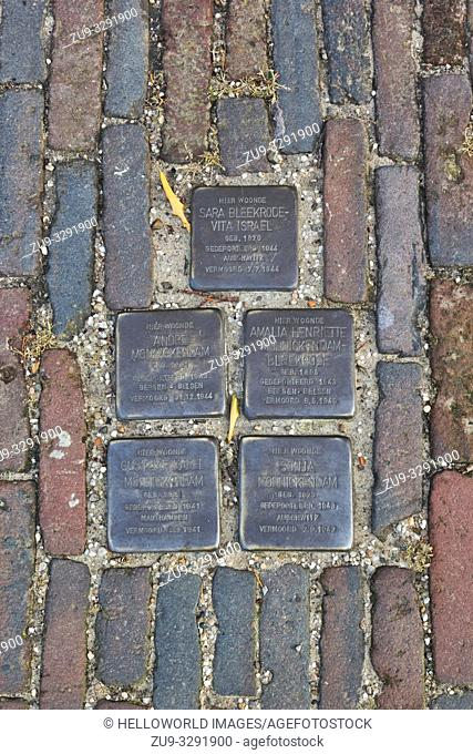 Brass plaques (Stolperstein) in the pavement in remembrance of Dutch Jewish holocaust victims, Amsterdam, Holland, Europe