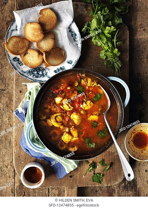 Seafood soup with grilled bread