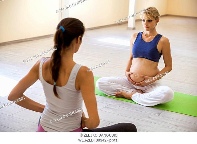 Prenatal yoga, female yoga instructor, breathing