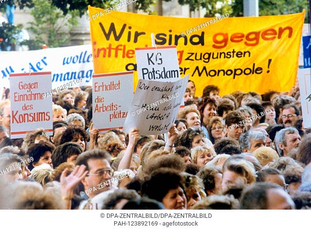 Thousands of employees demonstrate on 13 July 1990 in front of the Volkskammer in East Berlin for the preservation of their jobs as well as to draw attention to...