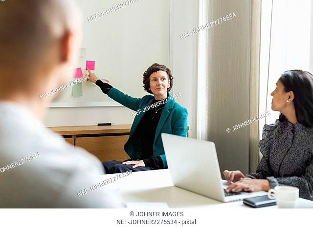 Three people at business meeting