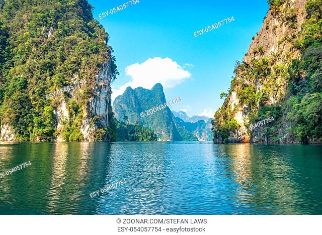 The national park Khao Sok with the Cheow Lan Lake is the largest area of virgin forest in the south of Thailand. Limestone rocks
