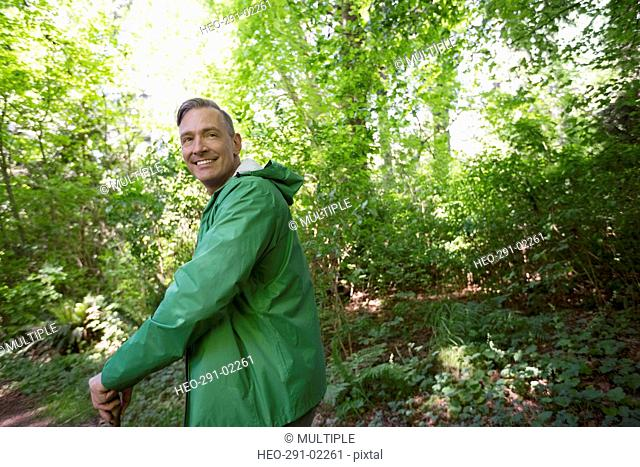 Portrait smiling man hiking in woods