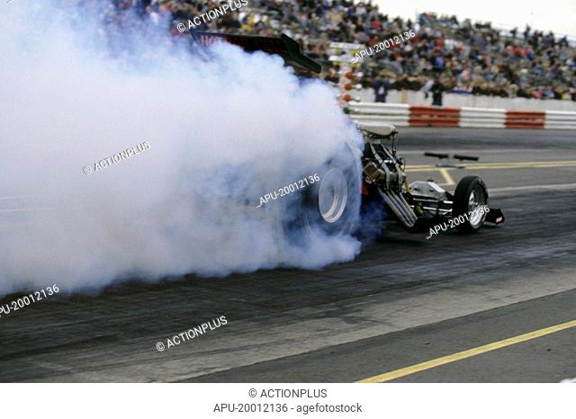 Top Fuel Car leaving starting line at a drag race