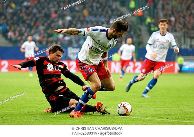 Hamburg's Dennis Diekmeier (M)and Leverkusens Sebastian Boenisch (l) in a dual for the ball during the German Bundesliga soccer match between Hamburger SV and...