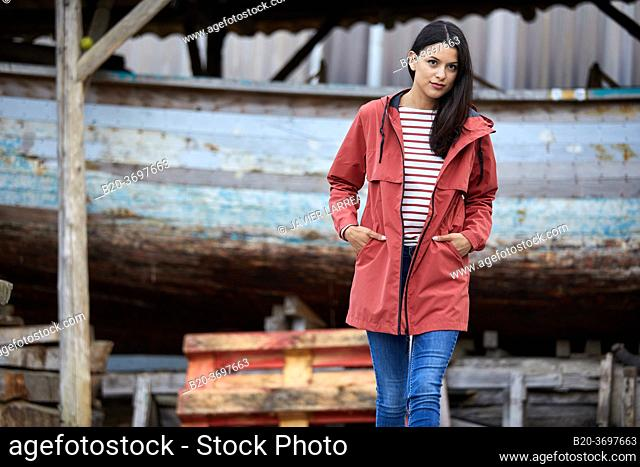 Young woman with raincoat, Pasaia, Gipuzkoa, Basque Country, Spain, Europe