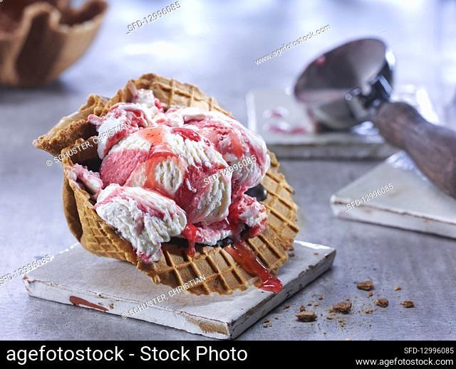 Strawberry yogurt ice cream in a waffle bowl
