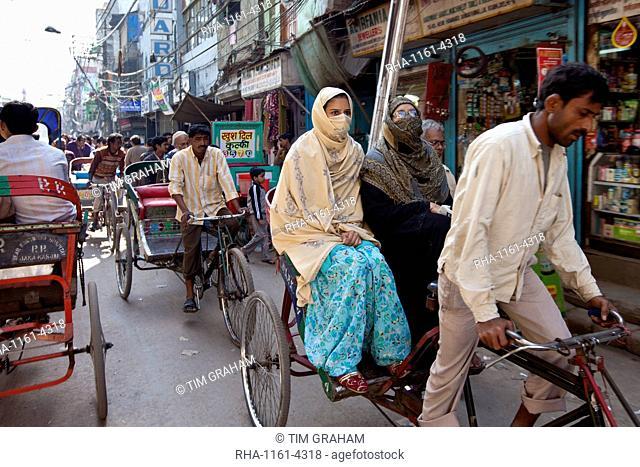 Muslim women in rickshaw in Old Delhi, India