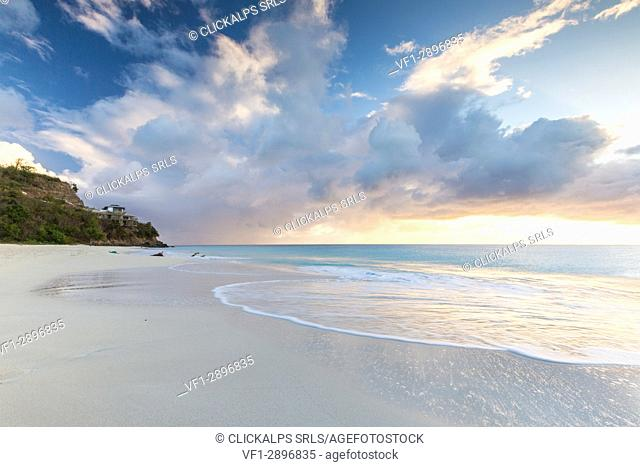 The sky turns pink at sunset and reflected on Ffryers Beach Caribbean Antigua and Barbuda Leeward Islands West Indies