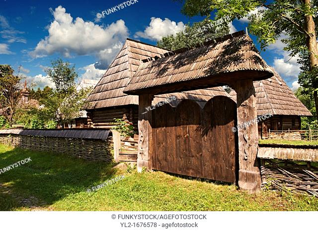 19th century traditional farm house & gate of the Iza Valley, The Village museum near Sighlet, Maramures, Northern Transylvania