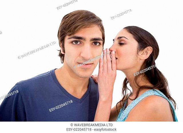 Woman whispering something to her boyfriend