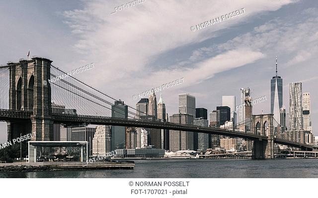 Brooklyn Bridge Over East River against Manhattan skyline, New York City, New York, USA