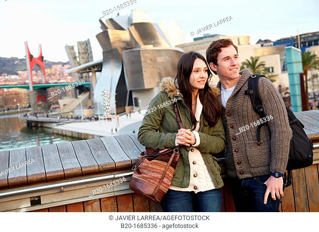Young couple visiting the city, Guggenheim Museum, Abandoibarra, Bilbao, Bizkaia, Basque Country, Spain