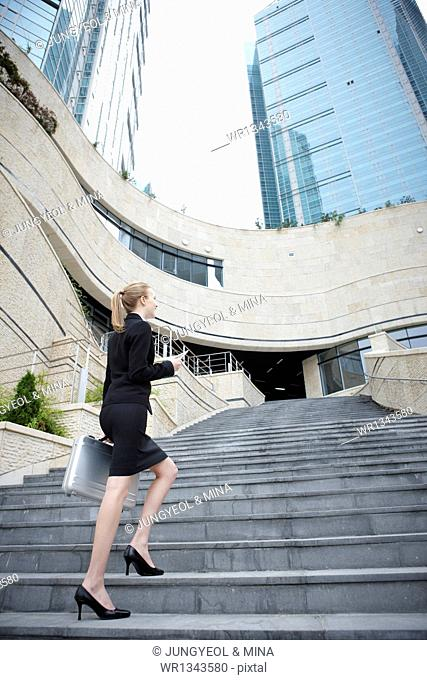 a business woman standing on the stairs