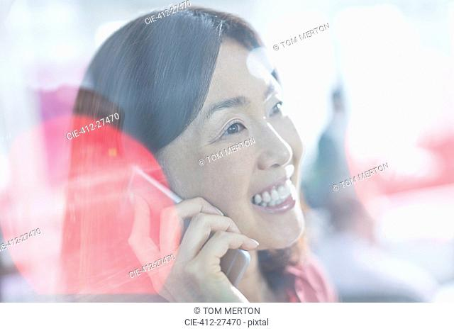 Close up smiling businesswoman talking on cell phone