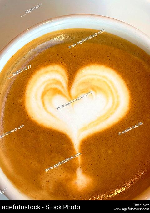 Cup of coffee with heart. Close view