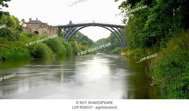 England, Shropshire, Coalbrookdale, View of the Iron bridge over the river Severn at Coalbrookdale. This was the world's first cast iron bridge built in 1779