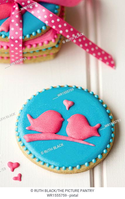 Lovebird cookies tied with a ribbon
