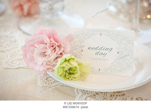 a card saying wedding day placed on a plate