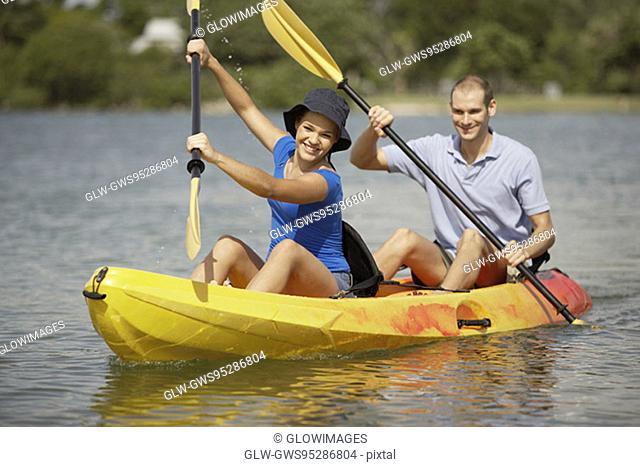 Portrait of a teenage girl and a young man kayaking