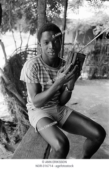 Young man listening to the radio Guinea-Bissau 1984