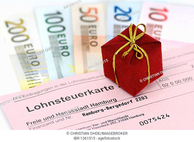 Tax card, gift and banknotes, symbolic image of tax giveaway