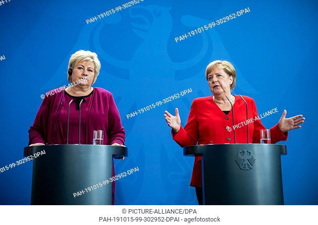 15 October 2019, Berlin: Federal Chancellor Angela Merkel (CDU, r) speaks at a press conference alongside Erna Solberg, Prime Minister of Norway