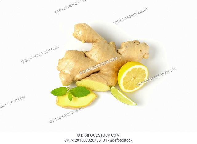 fresh ginger root with lemon and lime on white background