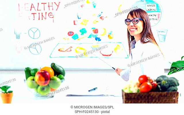 Nutritionist, dietician working in the office