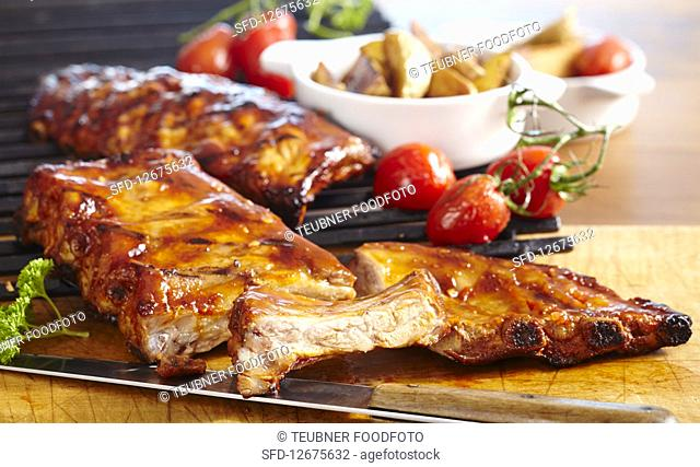 Grilled spare ribs in a BBQ marinade with roast potatoes