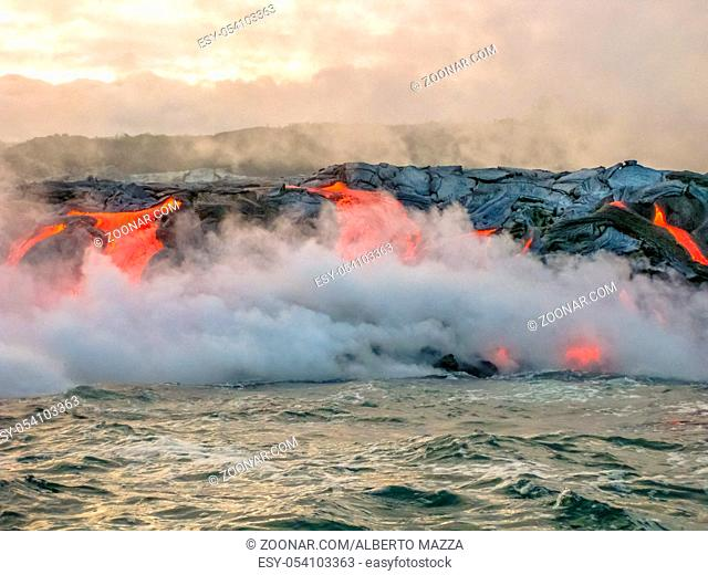 Scenic view from boat of Kilauea Volcano in Hawaii Volcanoes National Park, while erupting lava into Pacific Ocean, Big Island, Hawaii, United States