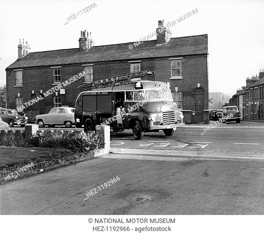1950 Bedford S type fire engine, (c1950?). A fire engine, returning from a call-out, turns into the station. Bedford's 7 ton S type lorry was first introduced...