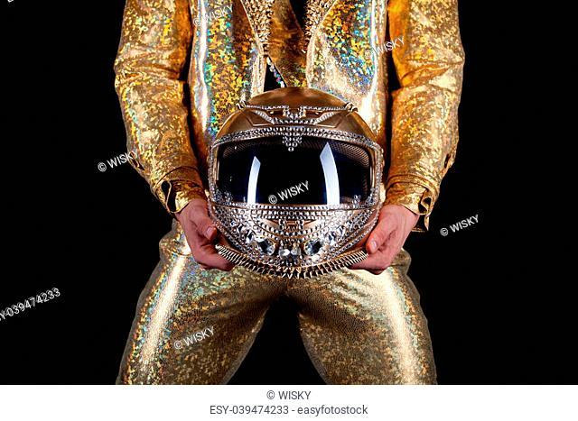 Portrait of male stripper holds helmet, on black background