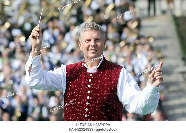 Munich's Lord Mayor Dieter Reiter (SPD) conducts the Oktoberfest bands in front of the Bavaria at the traditional 'Standkonzert' at the Oktoberfest 2014 in...