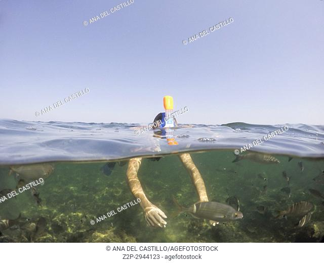 Man snorkeling in Denia San Antonio Cape nature reserve Alicante Spain