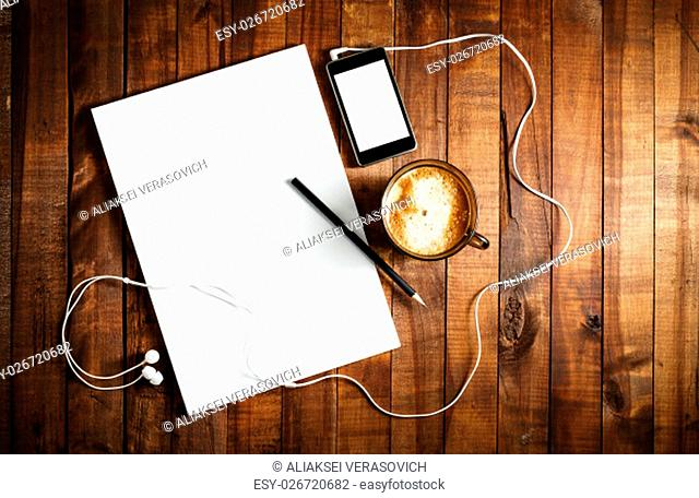 Blank stationery on vintage wooden table background. ID template. Mockup for branding identity for designers. Blank letterhead, coffee cup, phone