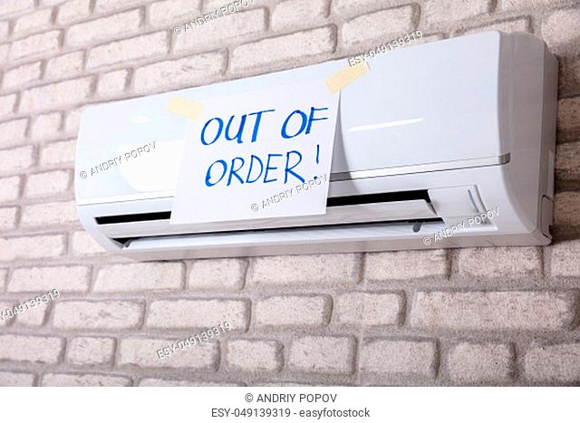 Out Of Order Text Paper Stick On White Air Conditioner In Living Room