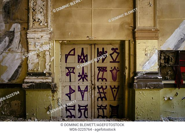 Art in the main ballroom in the abandoned Ballhaus Grunau, Berlin, Germany