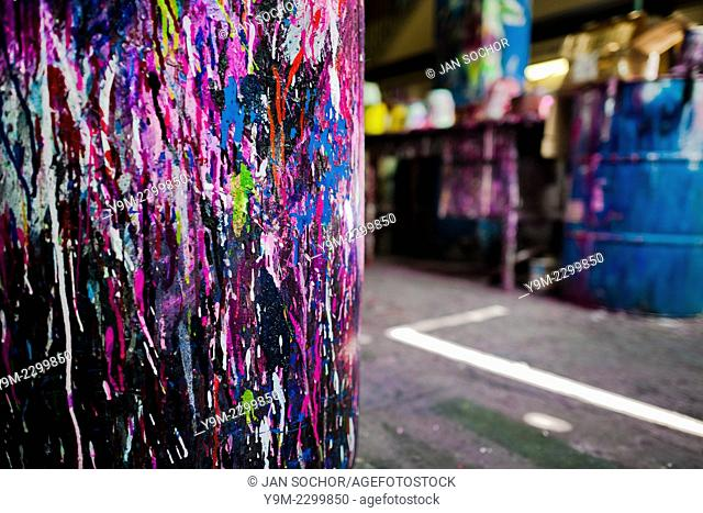 A plastic barrel, splattered with colorful paint, is seen in a small scale bicycle factory in Cali, Colombia, 27 June 2014