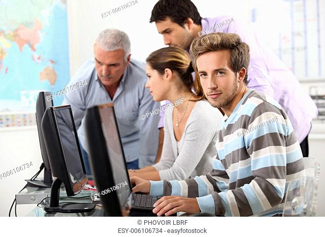 Mature students at computers