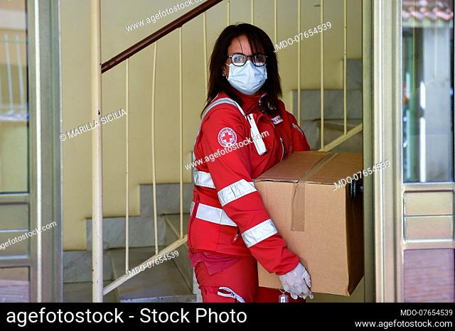Coronavirus emergency (Covid 19). Volunteers of the Italian Red Cross engaged in the delivery of groceries and medicines at home