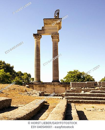 Restored columns of twin Corinthian temple in first Roman Forum of Glanum. Saint Remy de Provence, Bouches du Rhone, Provence, France