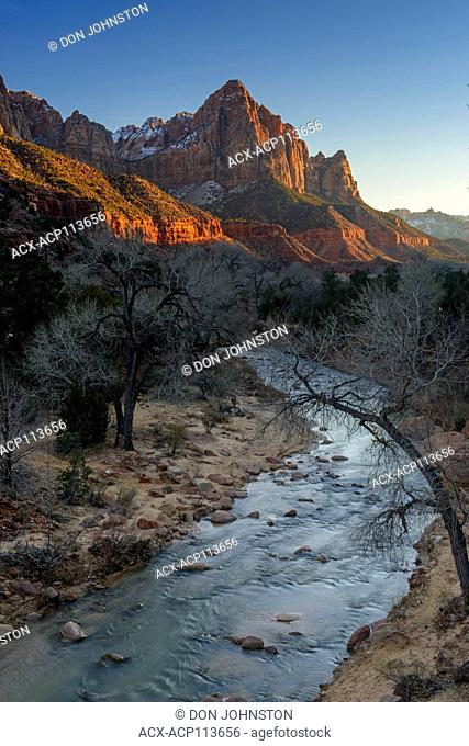 Alpenglo on the Watchman mountain with the Virgin River, Zion National Park, Utah, USA