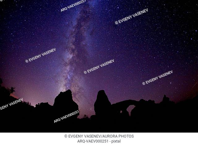 The Milky is visible above the Majestic Arches Nation Park at night