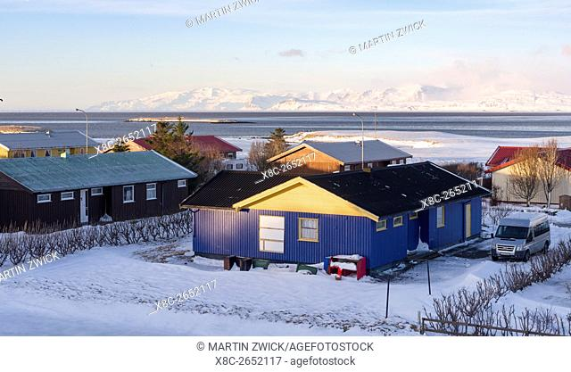 Hoefn i Hornafirdi, living quarter with view towards the mountains of the Vatnajoekull NP. europe, northern europe, iceland, February