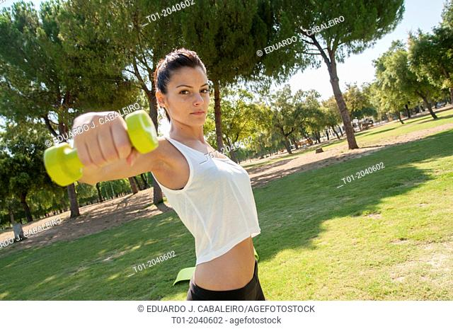 girl doing sports in a park