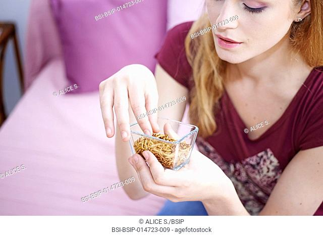 Woman eating mealworms